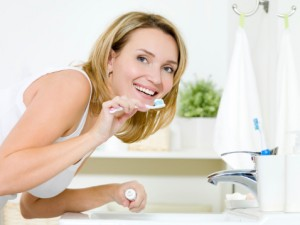 Brush and floss implants as you would natural teeth