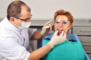 Woman receives treatment from the best houston oral surgeon Piney point oral and maxillofacial surgery