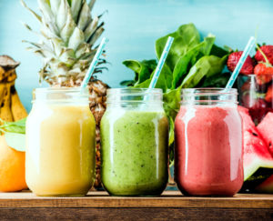 fresh blended fruit smoothies in glass jars