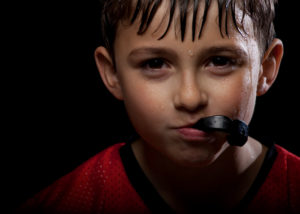 Young boy wearing sports mouth guard