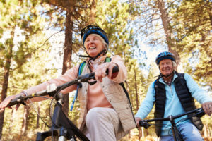 Old couple riding bicycles together
