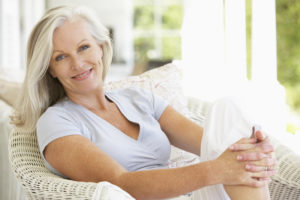 older woman on a sunlit porch