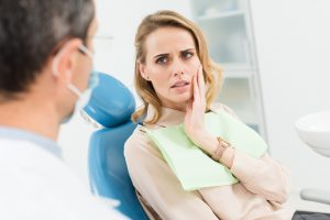woman with a toothache at the dentist