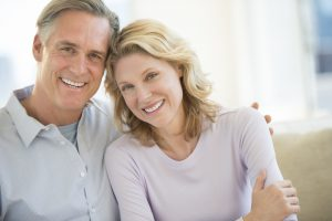 man and woman smiling at home