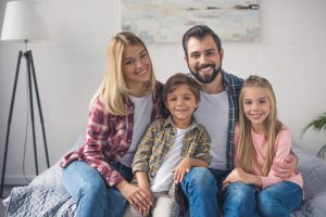 portrait of a smiling family at home