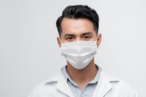 oral surgeon wearing white ASTM medial face mask