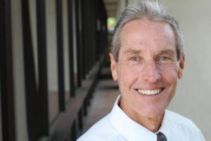 Man wearing implant dentures after visiting Houston oral surgeon