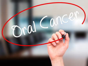"""Oral cancer"" in white lettering, circled by red"